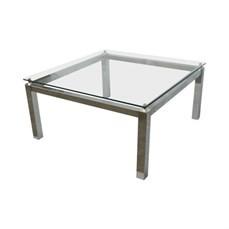 Mesa de centro com estrutura cromada e tampo de vidro
