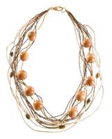 LR.C24 Colar de fios de palha de arroz, fios de corda de buriti, esferas de madeira e canutilho de cerâmica.