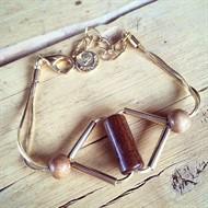 M.P7 Puls triangulo madeira e metais banhados a ouro